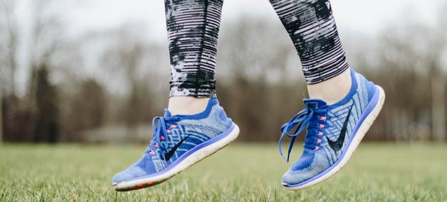 feet in sneakers jumping