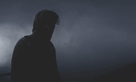 man silhouette stormy sky behind him