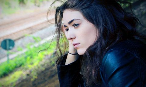 teen girl looking pensive