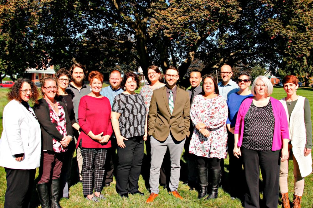 Compass Mark staff members pose out-of-doors