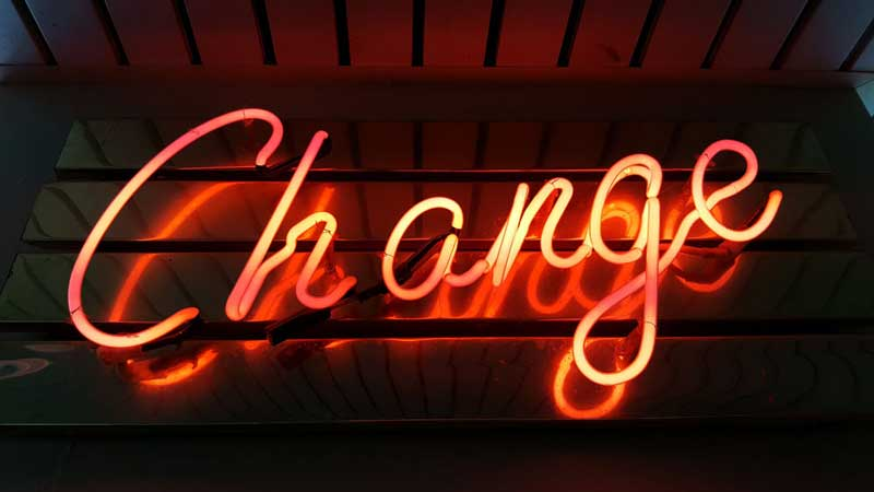 "Orange neon lights spell ""Change"""