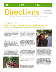 The front cover from Compass Mark's spring newsletter, in green and gold