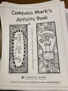 "A black and white drawing with bookmarks to color and the headline ""Compass Mark's Activity Book"""