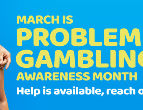 Problem Gambling Awareness month banner shows a couple- presenting as male and female- standing casually with one's arm around the other.